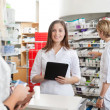 Female Pharmacist Holding Tablet PC — Stock Photo
