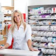 Stock Photo: Female Pharmacist Standing at Checkout Counter