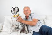 Senior Man Sitting With His Dog — Stock Photo