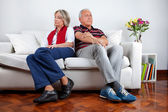 Couple Sitting on Sofa After Quarrel — Stock Photo