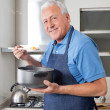 Senior Man Tasting Food — Stock Photo
