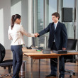 Businesspeople Shaking Hands - Lizenzfreies Foto
