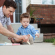 Father Drawing With Chalk on Ground — Stock Photo