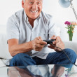 Senior Man Playing Video Game - Stockfoto