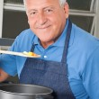 Stock Photo: Man Tasting Food From Spoon