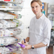 Stock Photo: Male Pharmacist Working at Drugstore