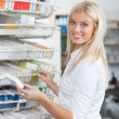 Woman Standing in Pharmacy Drugstore — Stock Photo