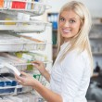 Woman Standing in Pharmacy Drugstore — Stock Photo