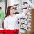 Stock Photo: Female at drugstore