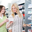 Female Pharmacist Advising Customer — Stock Photo