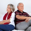 Stubborn Couple on Sofa - Stock Photo