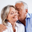 Husband Kissing Wife on Cheek - Stock Photo