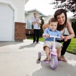 Loving Mother Teaching Son To Ride Tricycle — Stockfoto