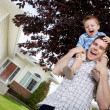 Father with Toddler Son on Shoulders - Foto de Stock