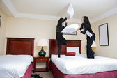 Female Executives Playing Pillow Fight — Stock Photo