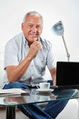 Smiling Senior Man With Laptop on Table — Stock Photo