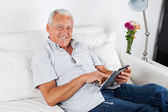 Senior Man Using Digital Tablet PC — Stock Photo
