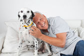 Senior Man Sitting With His Pet Dog — Stock Photo