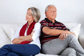 Stubborn Couple on Sofa — Stock Photo