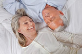 Couple Lying in Bed — Stock Photo