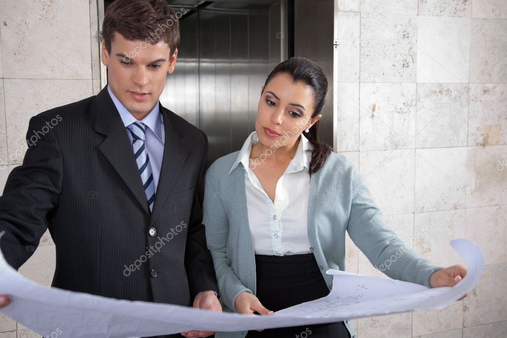 Professional business reviewing business plan in office — Stock Photo #7955341