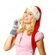 Woman in warm mittens and a red Santa Claus hat — Stock Photo #6829228