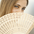 Beautiful Young Woman with a Fan — Stock Photo