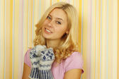 Beautiful young woman in mild winter mittens — Stock Photo