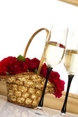 Basket with roses and champagne — Stock Photo