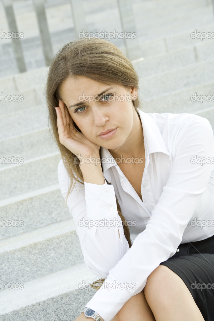Young business woman tormented by headaches cares about the work — Stock Photo #6829292