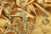 Tło złoto tkaniny — Zdjęcie stockowe