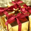 Colorful gift boxes tied with ribbons - Stock Photo