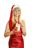 Young woman dressed as Santa with a gift. — Photo