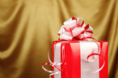 Christmas gift in a red box — Stock Photo