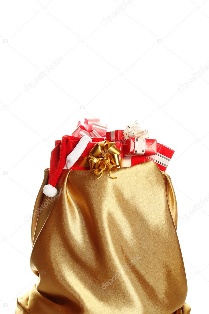 Sack of gold color filled to the brim with Christmas gifts. Isolated on a white background — Stock Photo #6885948