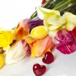 Stock Photo: Tulips and two red hearts