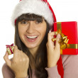 Christmas woman with gifts smiling — Stok fotoğraf