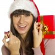Christmas woman with gifts smiling - Foto Stock