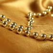 Stock Photo: Background of golden fabric