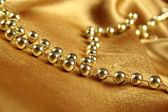 金色织物的背景 — 图库照片
