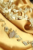 Background of golden fabric — Stockfoto