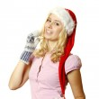 Woman in warm mittens and a red Santa Claus hat — Stock Photo