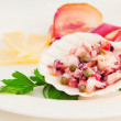 Octopus salad served with cheese and prosciutto on the side — Stock Photo #7000907