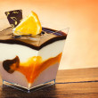 Chocolate & vanilla pudding with orange — Stock Photo