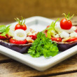 Aubergine towers with mozzarella, tomato and basil - Stock Photo
