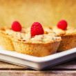Mini fruit pies decorated with raspberries — Stock Photo #7001137