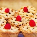 Mini fruit pies decorated with raspberries — Stock Photo #7001162