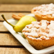 Closeup of mini pies on a plate decorated with cinnamon and a pear — Stock Photo #7001216