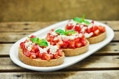 Bruschetta ( Italian Toasted Garlic Bread ) — Stock Photo
