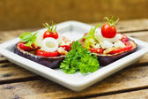 Aubergine towers with mozzarella, tomato and basil — Stock Photo